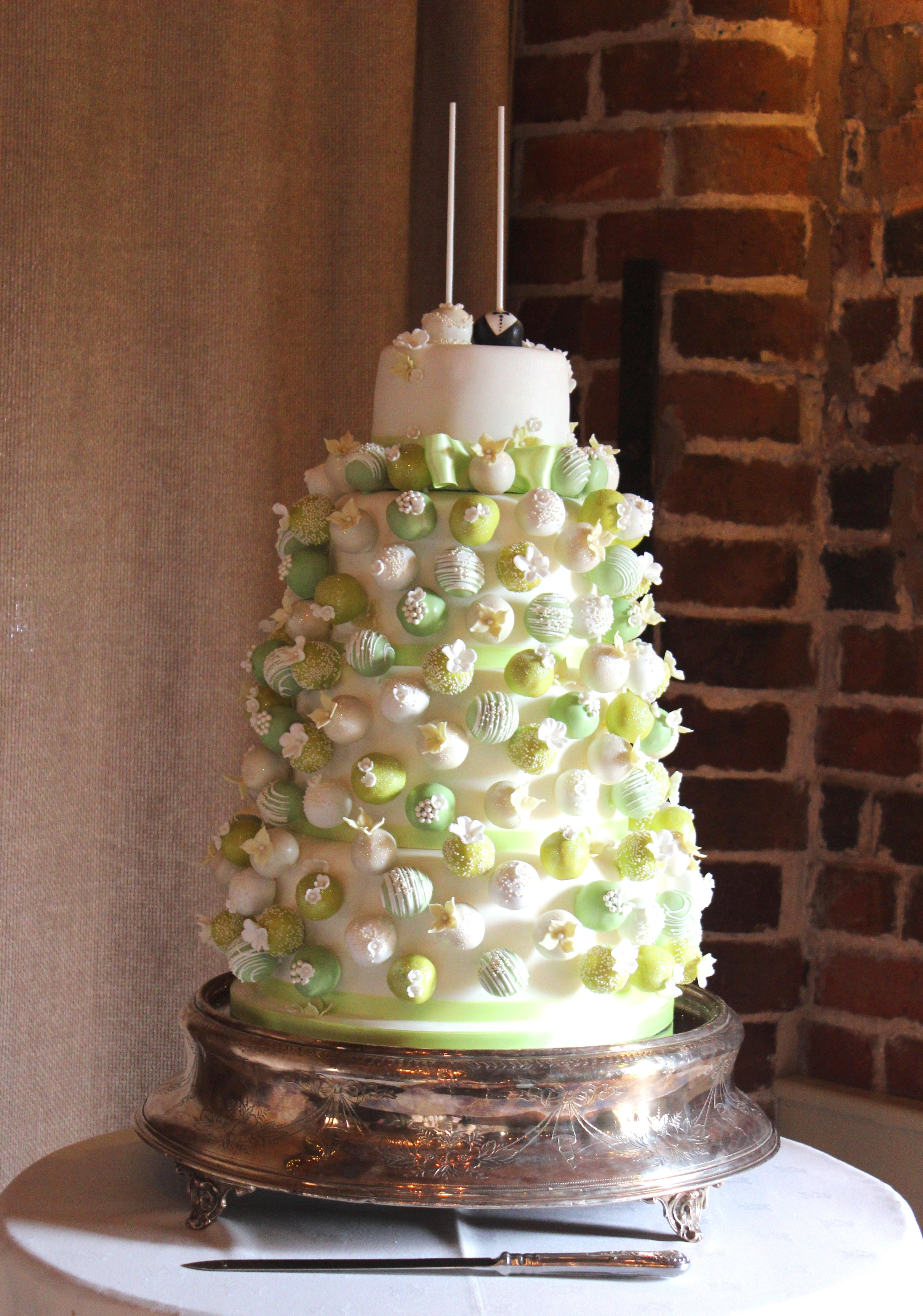A wedding cake completely covered in cake pops for charlotte and ben