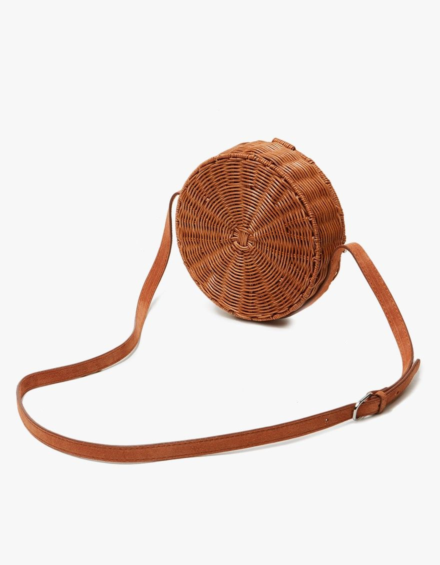 Crossbody bag from Rachel Comey in Honey-Melon. Adjustable suede strap. Front opening with magnetic fastening. Suede lined. Polished silver hardware.  •Wicker •Leather lining •Made in the Philippines