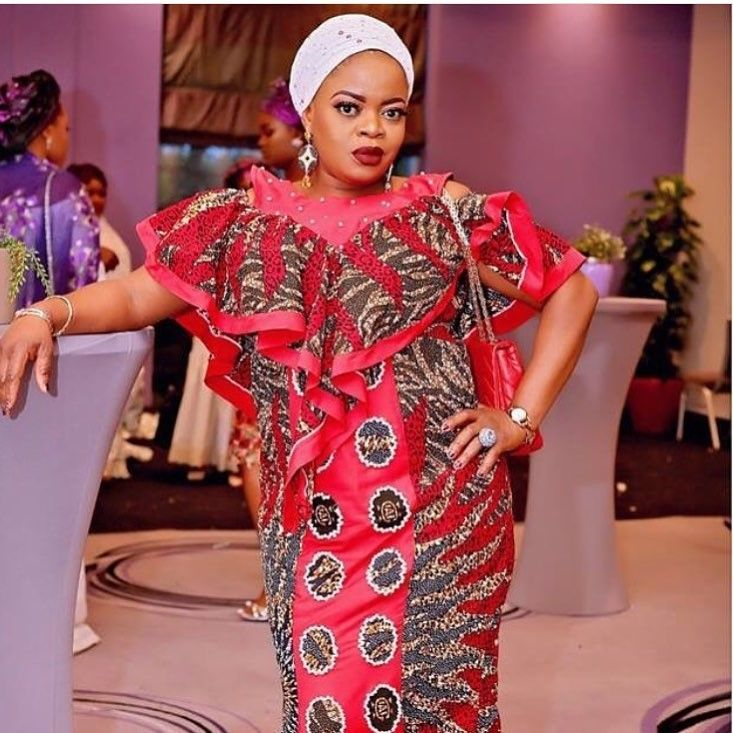 There are several ways to enable yourself beautiful with an Ankara fabric, Even if you are contemplating about what to create and slay with an latest asoebi styles. Nigerian Yoruba dress styles for parties arrive in a good many patterns and designs.   The Ankara dress styles beauty of this print is that it comes in many designs and textures. Ankara will permit you create a accede of any cloth without losing the  African Ankara dresses  flair. #nigeriandressstyles