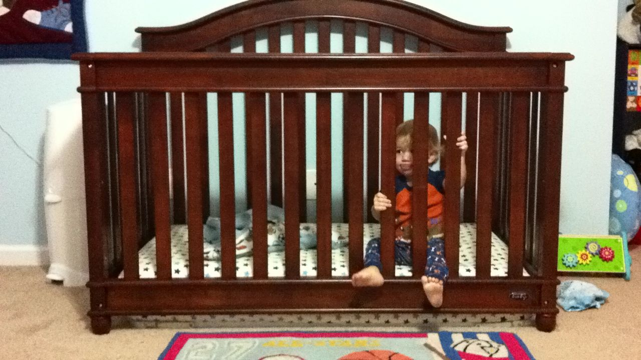 Baby climbing out of crib remove bed frame and place On the floor bed frames