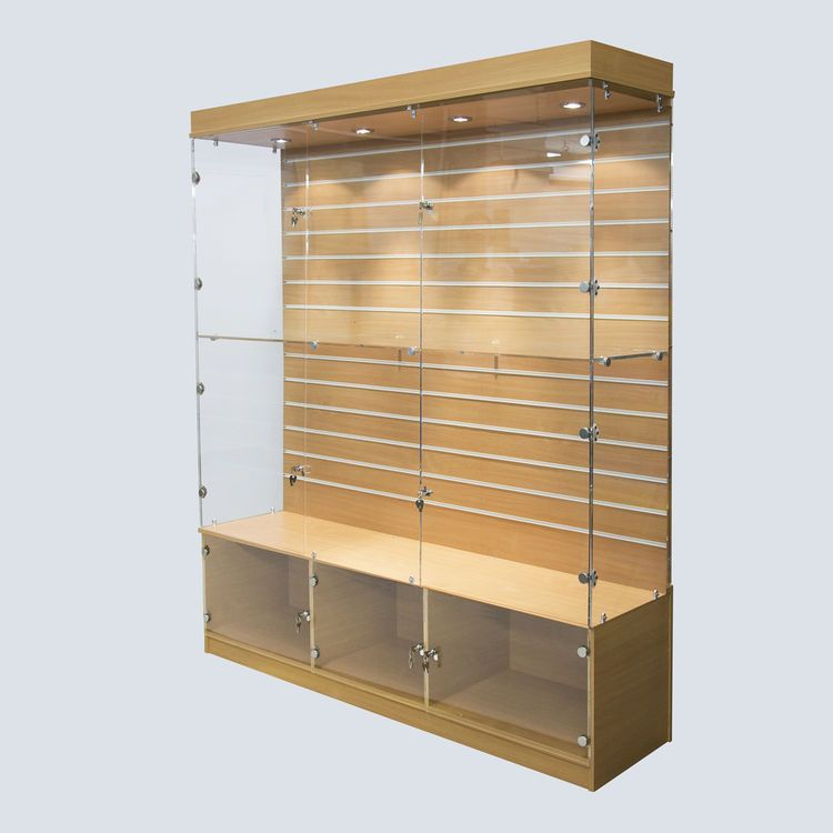 A Large Wood Finish Display Cabinet With A Slat Wall Back Panel And Useful Lockable Storage In