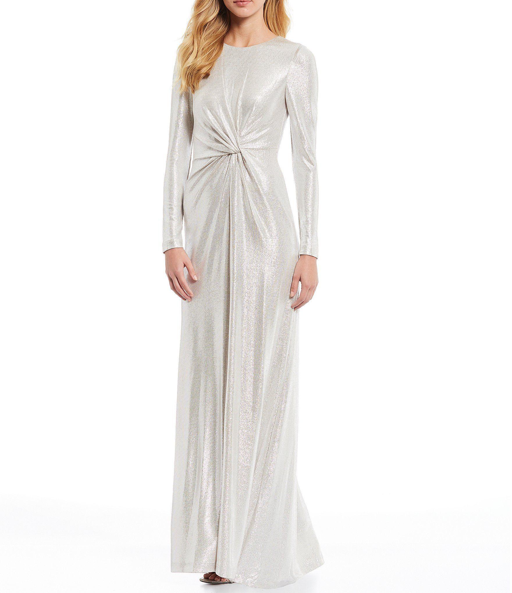 Eliza J Metallic Long Sleeve Knot Front Gown Dillards Dillards Wedding Dresses Elegant Wedding Dress Stylish Wedding Dresses [ 2040 x 1760 Pixel ]