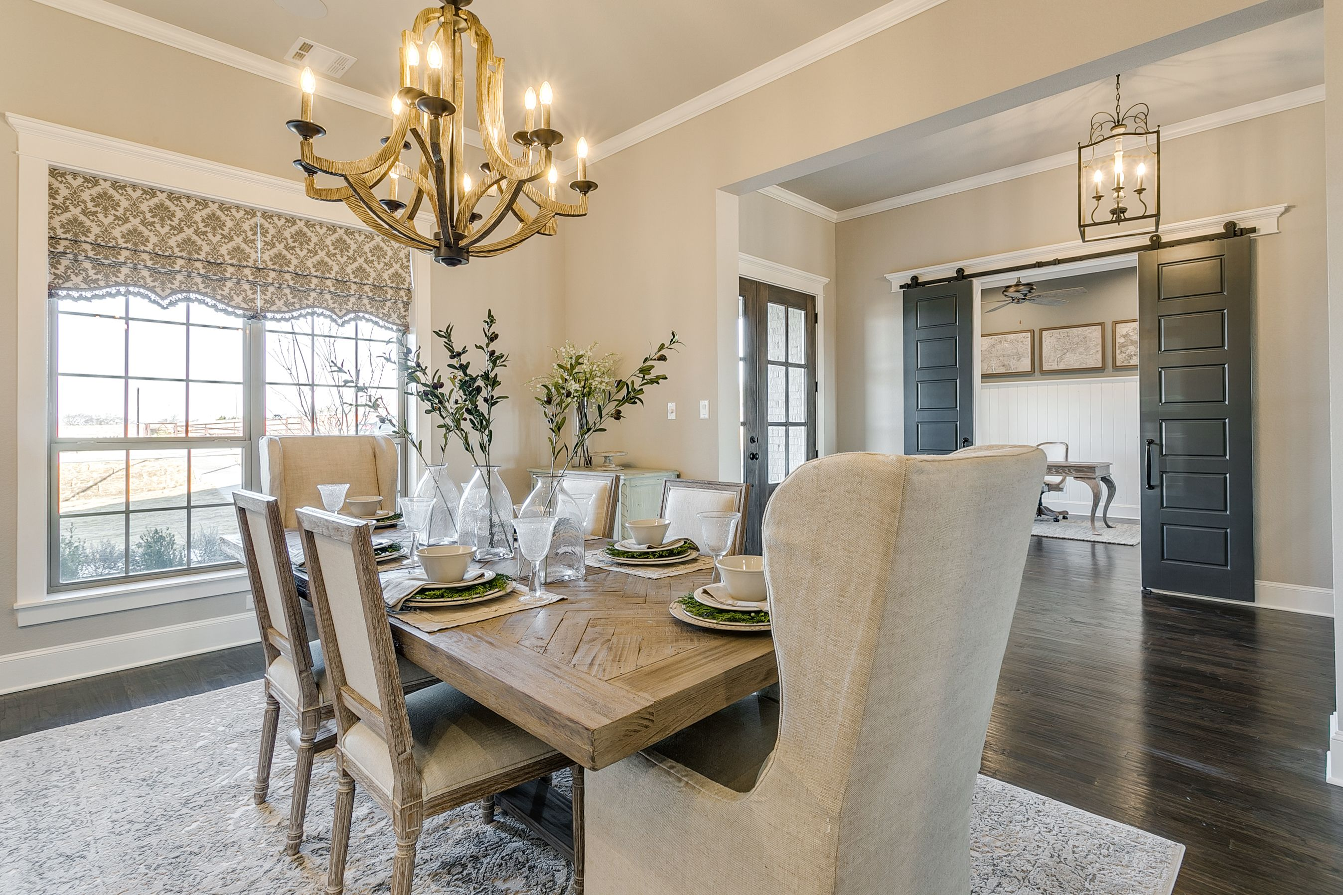 Dining Room At Entry With Wood Floors And Chandelier Legacy