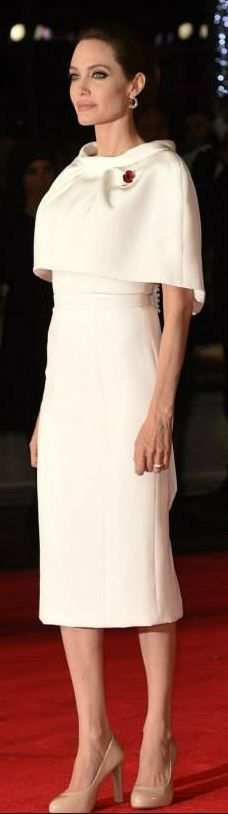 Who made Angelina Jolie's white cape sleeve dress that she wore in London on November 25, 2014? (OutfitID) -  Angelina Jolie  - #Angelina #AngelinaJolie #cape #CelebrityStyle #dress #HollywoodActresses #Jolies #littletattooideas #london #November #OutfitID #skulltattoo #Sleeve #unusualtattoos #White #wore