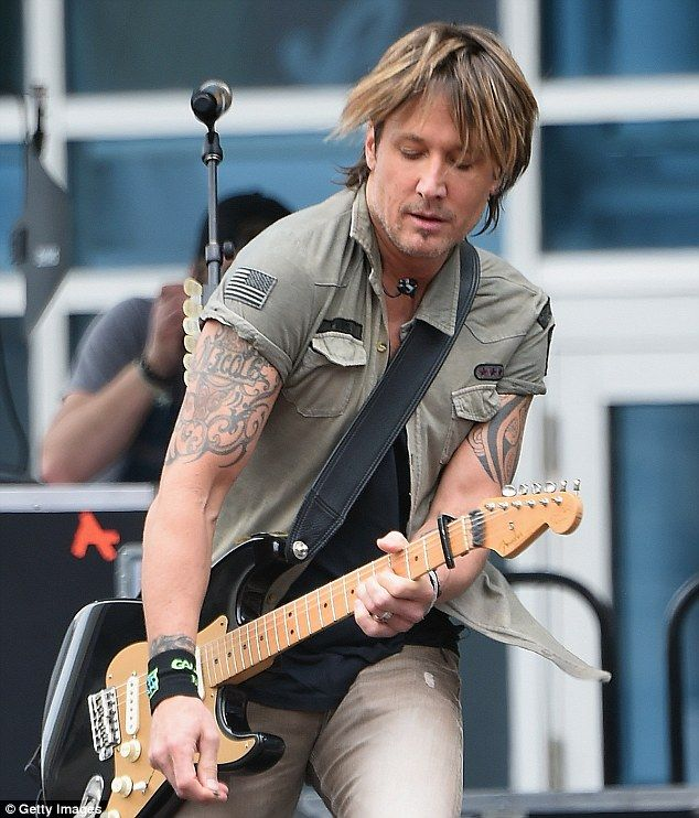 Electric! Keith Urban performs older and new music from his new album Ripcord during a free concert at Bridgestone Arena, Nashville, Tennessee, on Monday