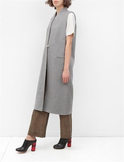 Wool and cashmere sleeveless coat over brown linen pants