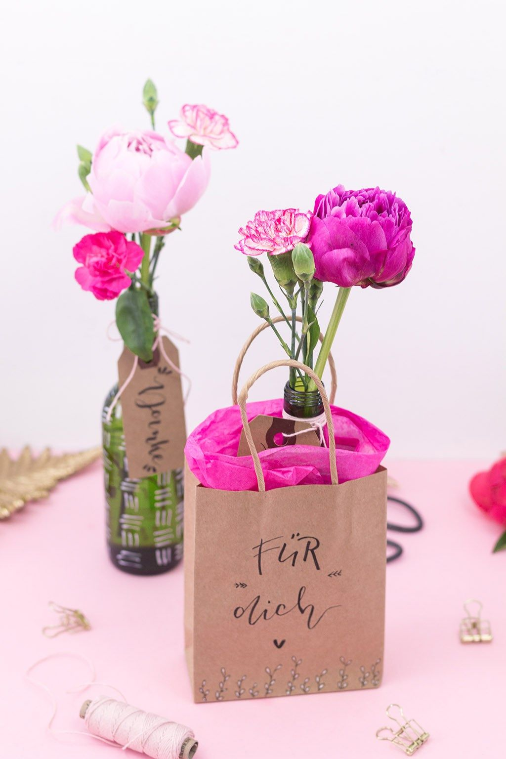 Photo of Beautifully pack flowers in upcycling vases from wine bottles