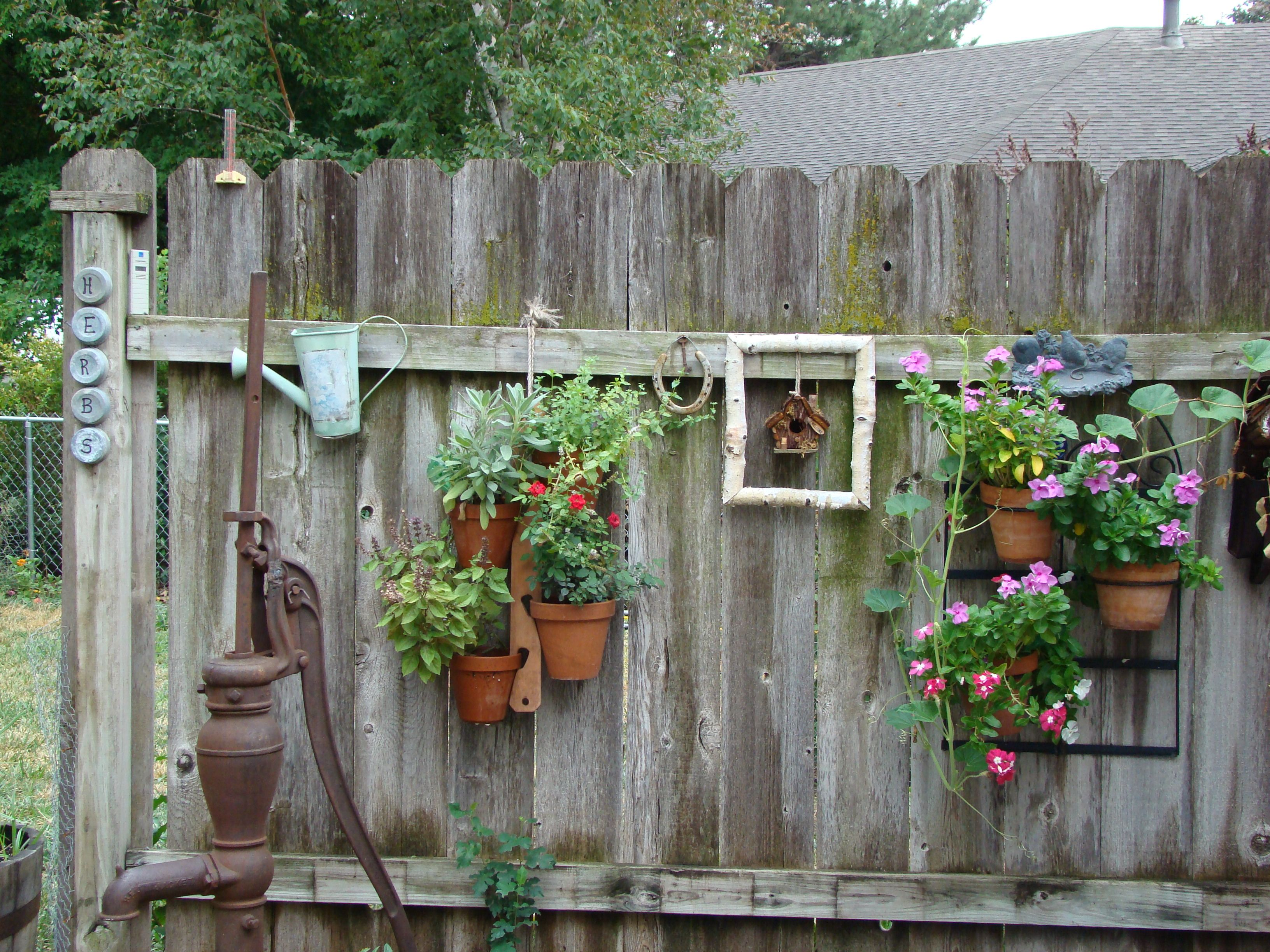 My patio fence decorated with old worn out things