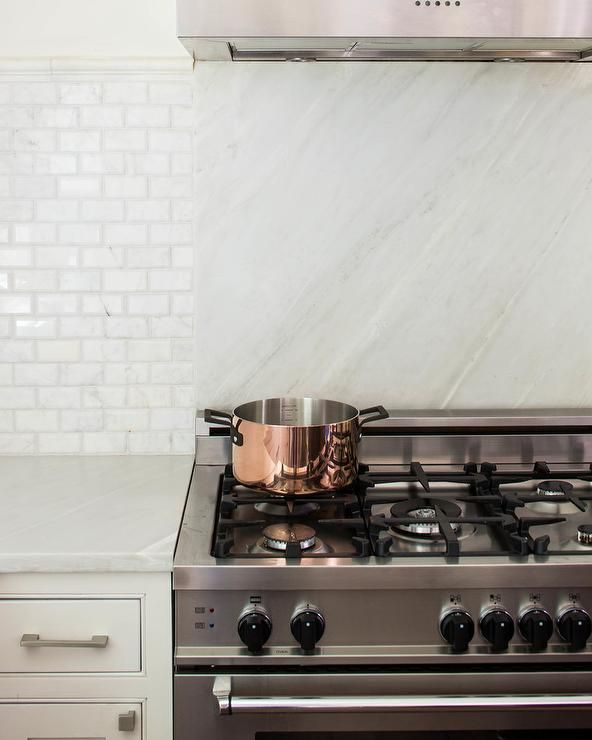 A Two Toned Backsplash Includes A White Marble Slab And White X2f Gray Subway Tile That Seemingly Divide Kitchen Backsplash Designs Marble Slab Kitchen Marble
