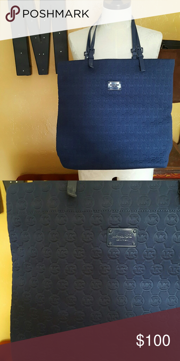 ce0aec377e9b ❌LAST CALL❌ Michael Kors Navy Neoprene Tote Gorgeous, soft and roomy. Navy Neoprene  Tote from Michael Kors! Gently used. Preloved but good condition.