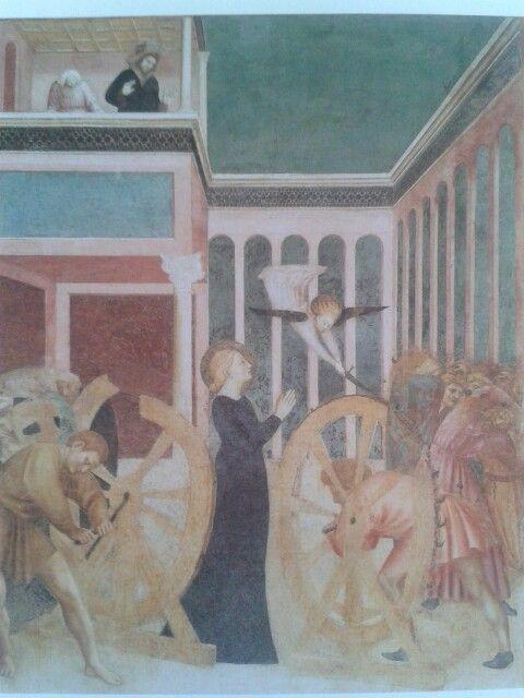 El martirio de Santa Catalina de Alejandria. Pintada por Masolino di Panicale hacia el año 1428 en la Capella Branda Castiglioni de San Clemente, Roma, Italia.