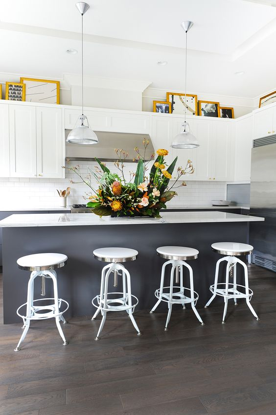 Decorating Above Kitchen Cabinets What S In What S Out In 2021 Above Kitchen Cabinets Decorating Above Kitchen Cabinets White Modern Kitchen