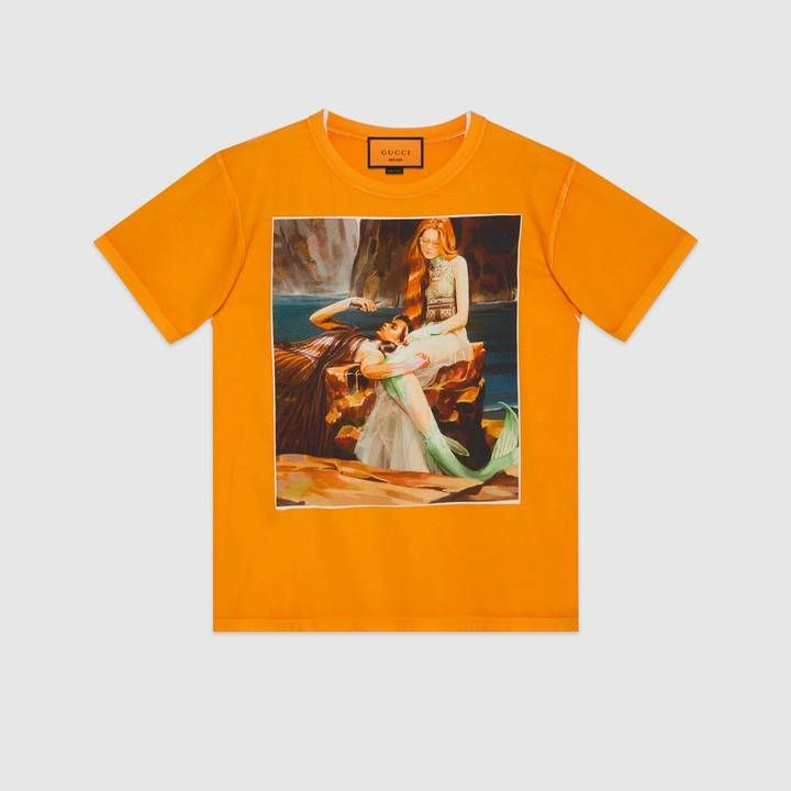 d1d2c8a8f Shop the Oversize #GucciHallucination T-shirt by Gucci. Mermaids on a rock  wearing the ice skater inspired gowns from the Spring Summer 2018  collection by ...