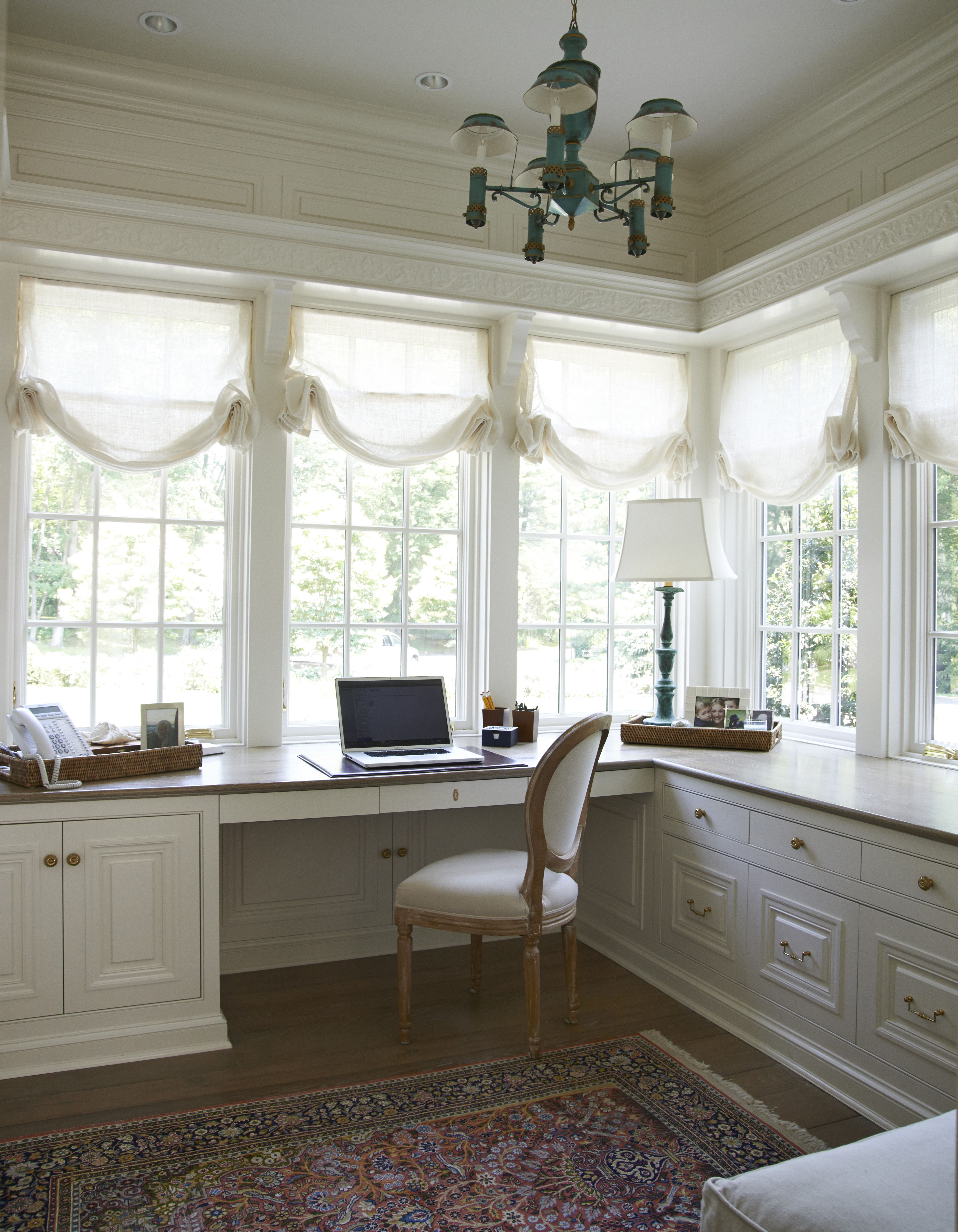 lots of windows and lights for an office Feminine home
