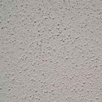 A Close Up Image Of A Fine Grade Textured Wall Coating On Smooth Render Wall.  This Paint Finish Will Last Upwards Of 20 Years On The Outside Of Your House