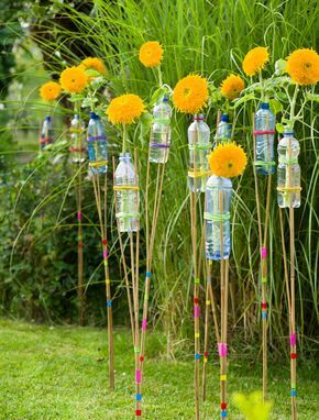 deko im garten selbstgemacht, deko für die gartenparty: sonnenblumen-fackeln ganz fix, Design ideen
