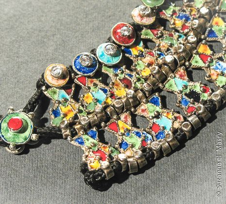 Detail: Large silver necklace with cloisonné enamel and tassels.By: Suzanne El Masry