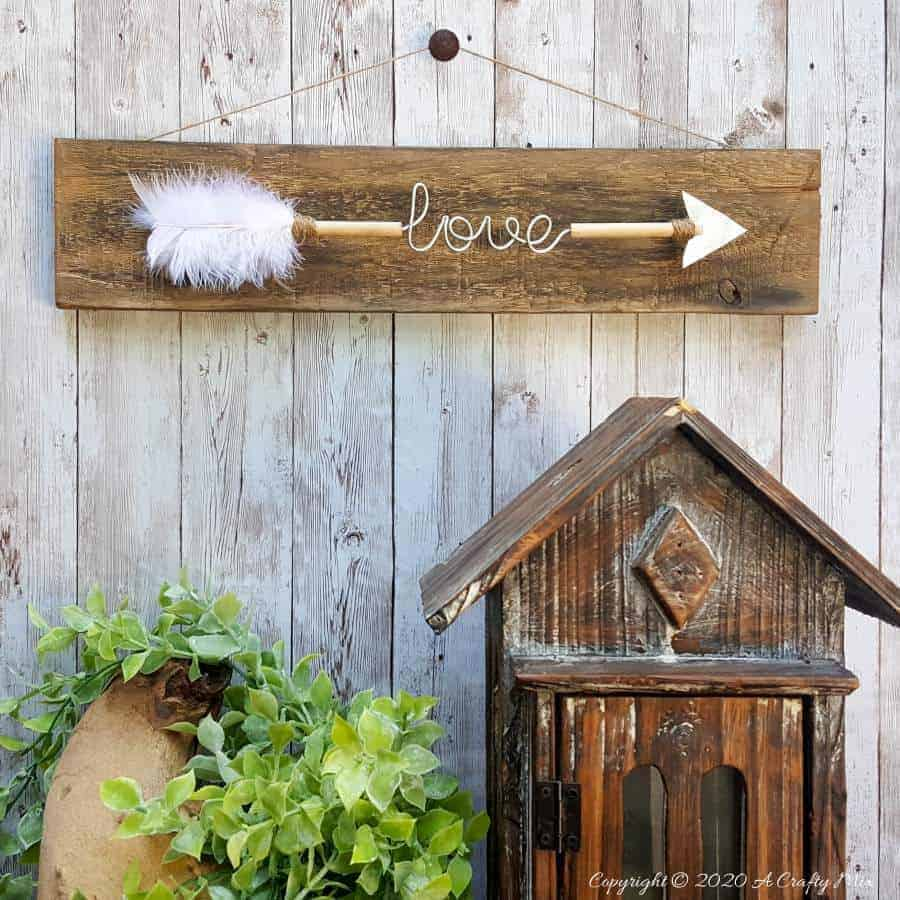 Make a gorgeous LOVE arrow sign to add to your gallery wall. It's fun, easy and you can customize the wire words to fit your unique style. #gallerywall #acraftymix #valentinesday #lovearrow #bohodecor #lovedecor #DIYArrowdecor #ArrowPrintable #arrowDIY #arrowcrafts #DIYWirewords