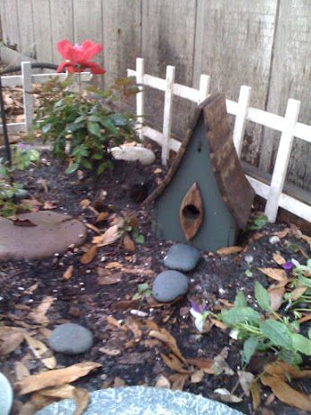 My Fairy House, made from a bird house and river rock path flat stones to sunbathe on and flowers to add beauty and fragrance.