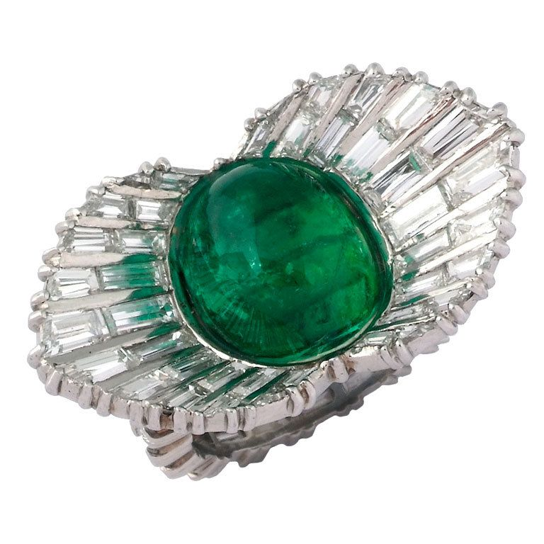 STERLE. An Emerald and Diamond Ring.