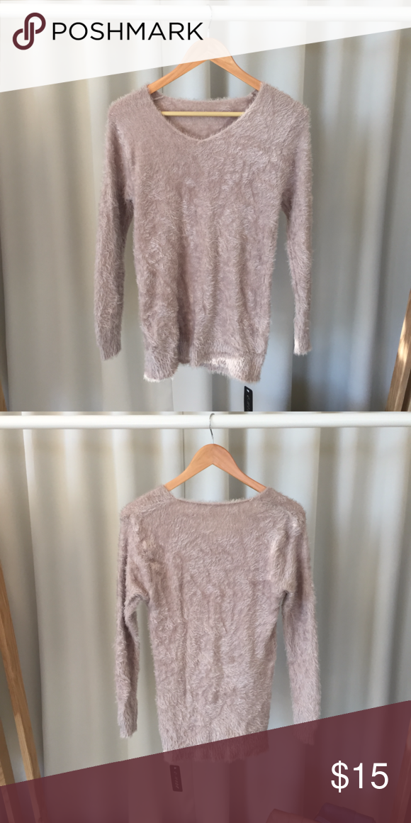 Tan Fuzzy Sweater Fuzzy sweater! With a V-neck line. Soft and comfortable. Stretchy material. Fits like a S/M Sweaters V-Necks