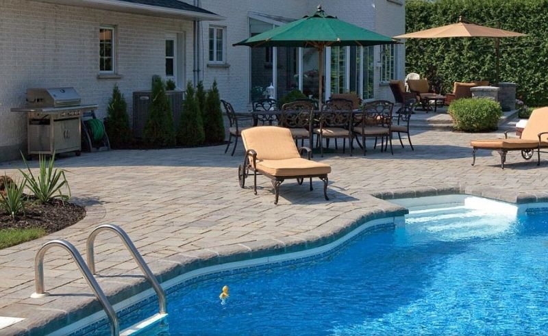 A Raised Paver Patio Leads To A Paving Brick Pool Deck. Landscape Plus LLC