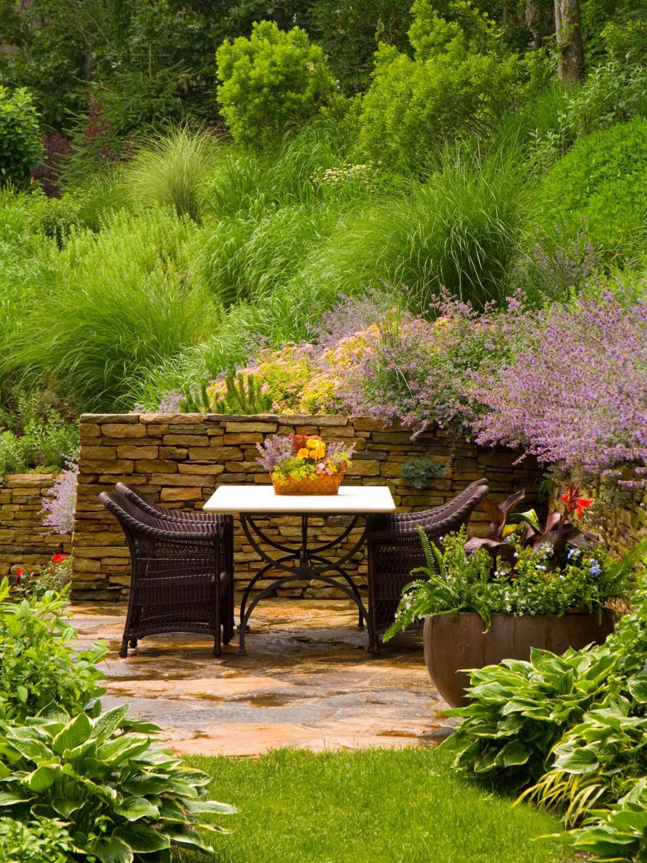 Garden Retreats | Stone retaining wall, Flowering shrubs and Stone ...