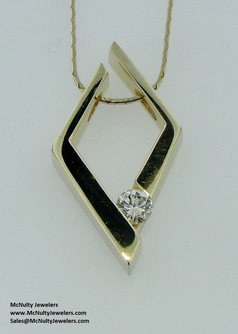 Yellow gold and diamond solitaire pendant.  McNulty Jewelers original design
