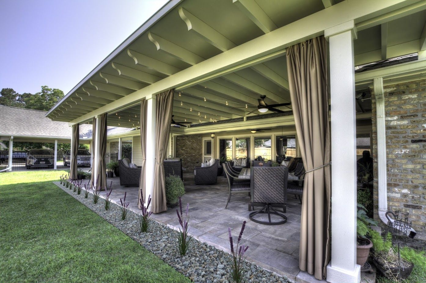 Outside View Of A Covered Patio With Open Curtains Custom Patio Cover Arbor In Baton Rouge Www Lasunrooms Com Patio Covered Patio Home Improvement