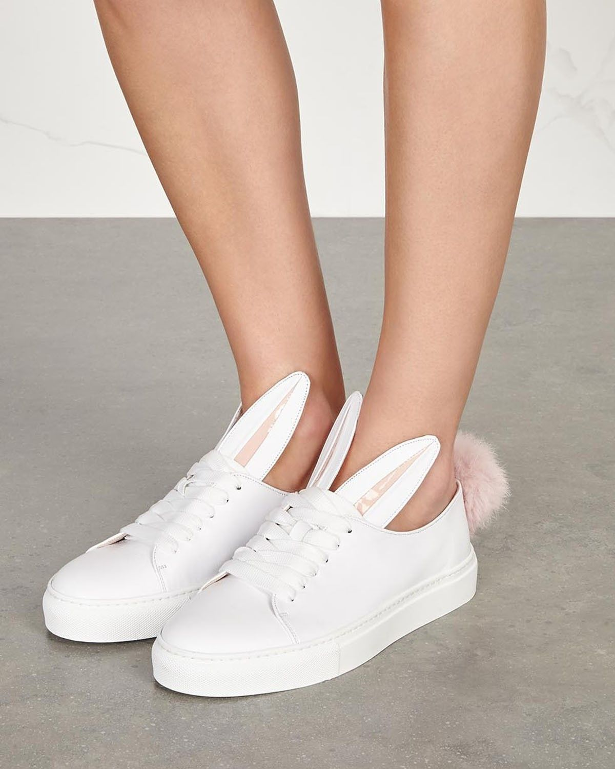 e78a96694ff3 Minna Parikka white leather trainers with pink rabbit fur pompom at heel,  pink patent leather-trimmed rabbit ears design, white rubber sole, round  toe.