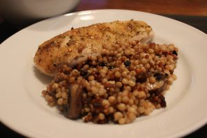 Chicken roasted over a bed of slow cooked couscous and mushrooms