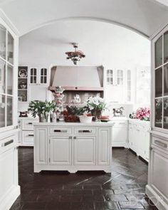 terracotta floor tiles are ugly and dated. especially in a kitchen