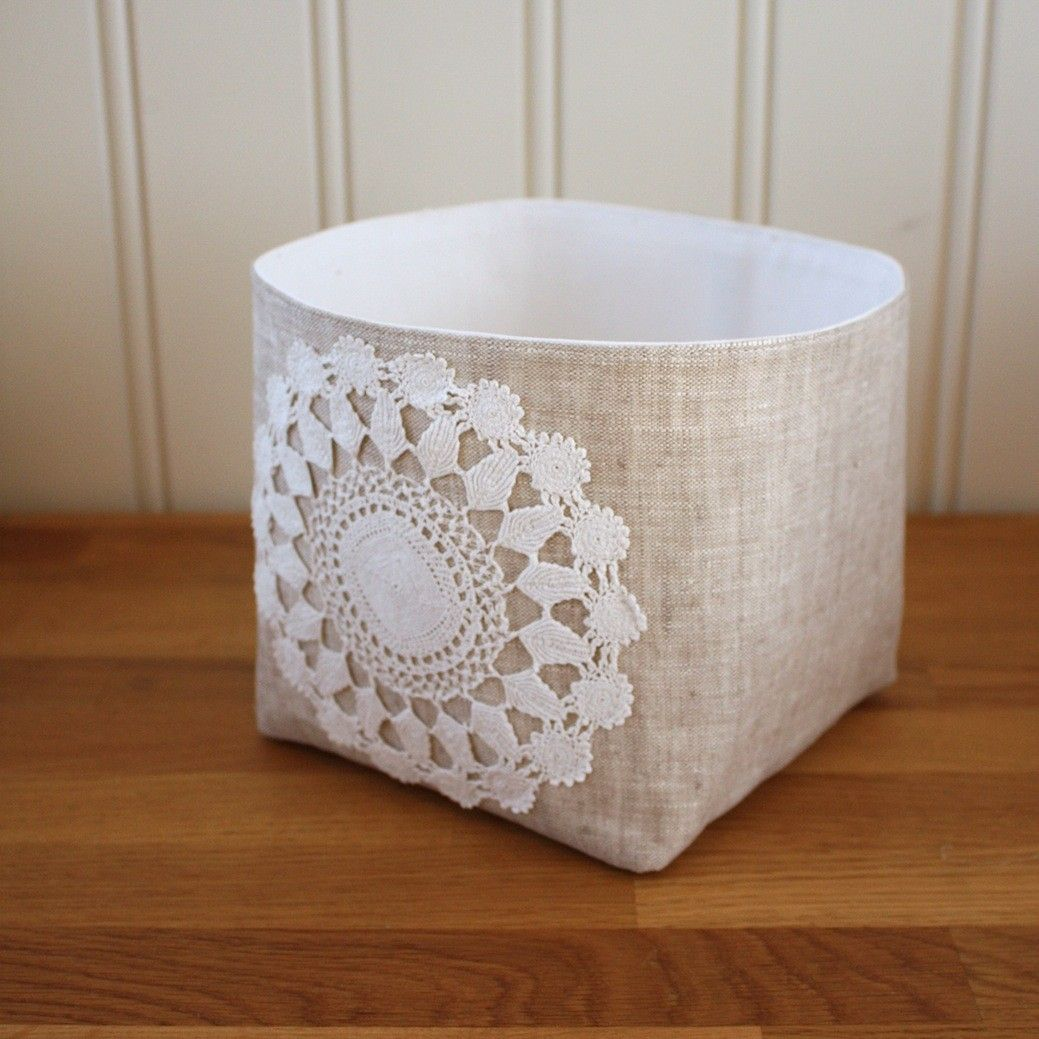 Idea: (this is an ad) - storage bin (6 in.) using natural linen & a real crocheted doily - note: bin had sides of all one piece..no corners except bottom