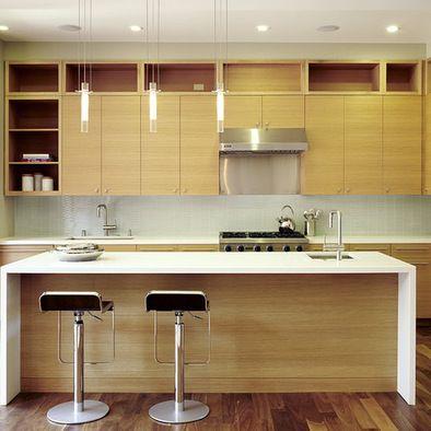 modern modern oak kitchen design. horizontal grain rift cut white oak cabinets with quartz counter  shows waterfall edge Modern KitchensContemporary