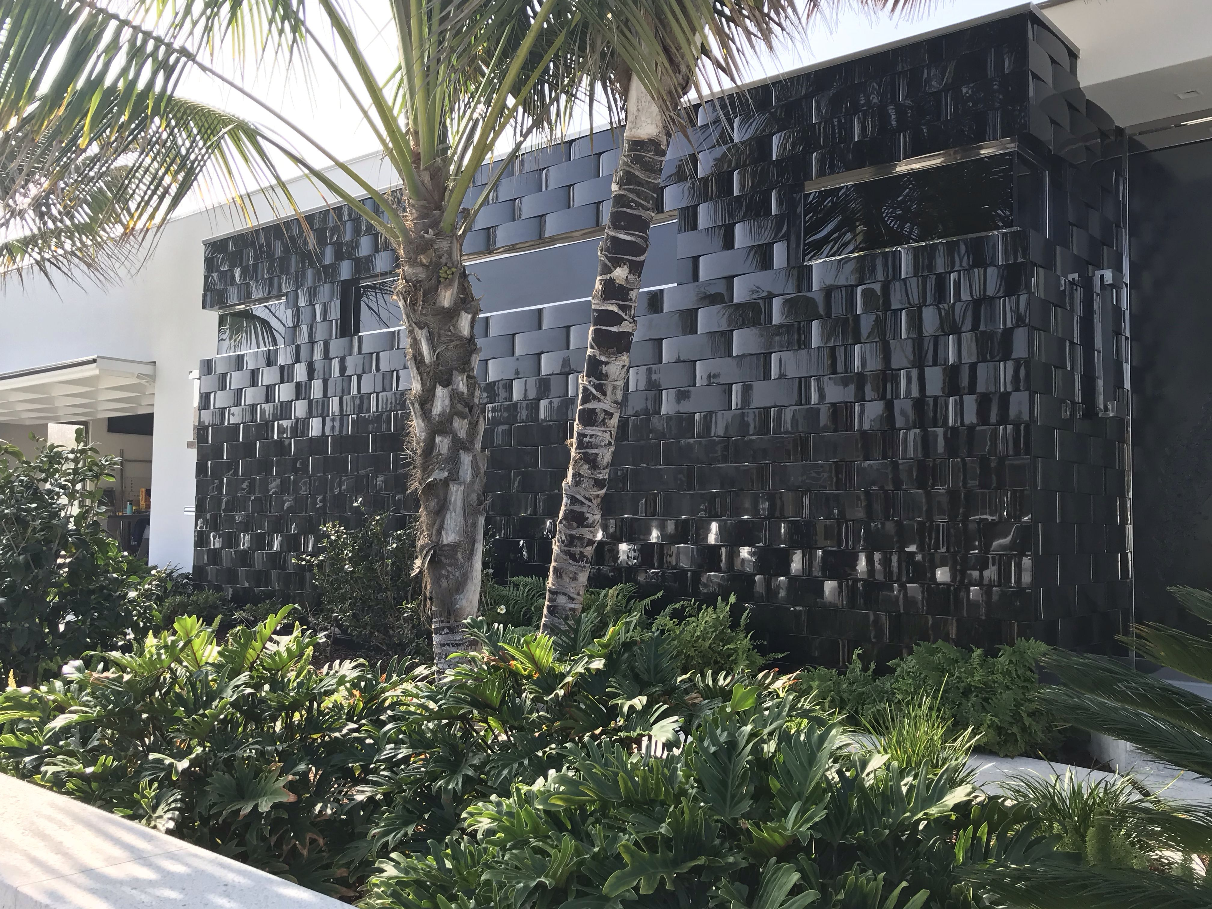 Contemporary House With Basket Weave Black Exterior Tile Feature