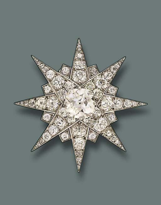 A FINE DIAMOND BROOCH, BY CARTIER   The central old-cut diamond weighing 5.33 carats to the eight-pointed star, early 1930s, 4.9 cm. wide, with French assay marks for platinum and gold  Signed Monture Cartier and with maker's mark SCA in lozenge, No. 143310