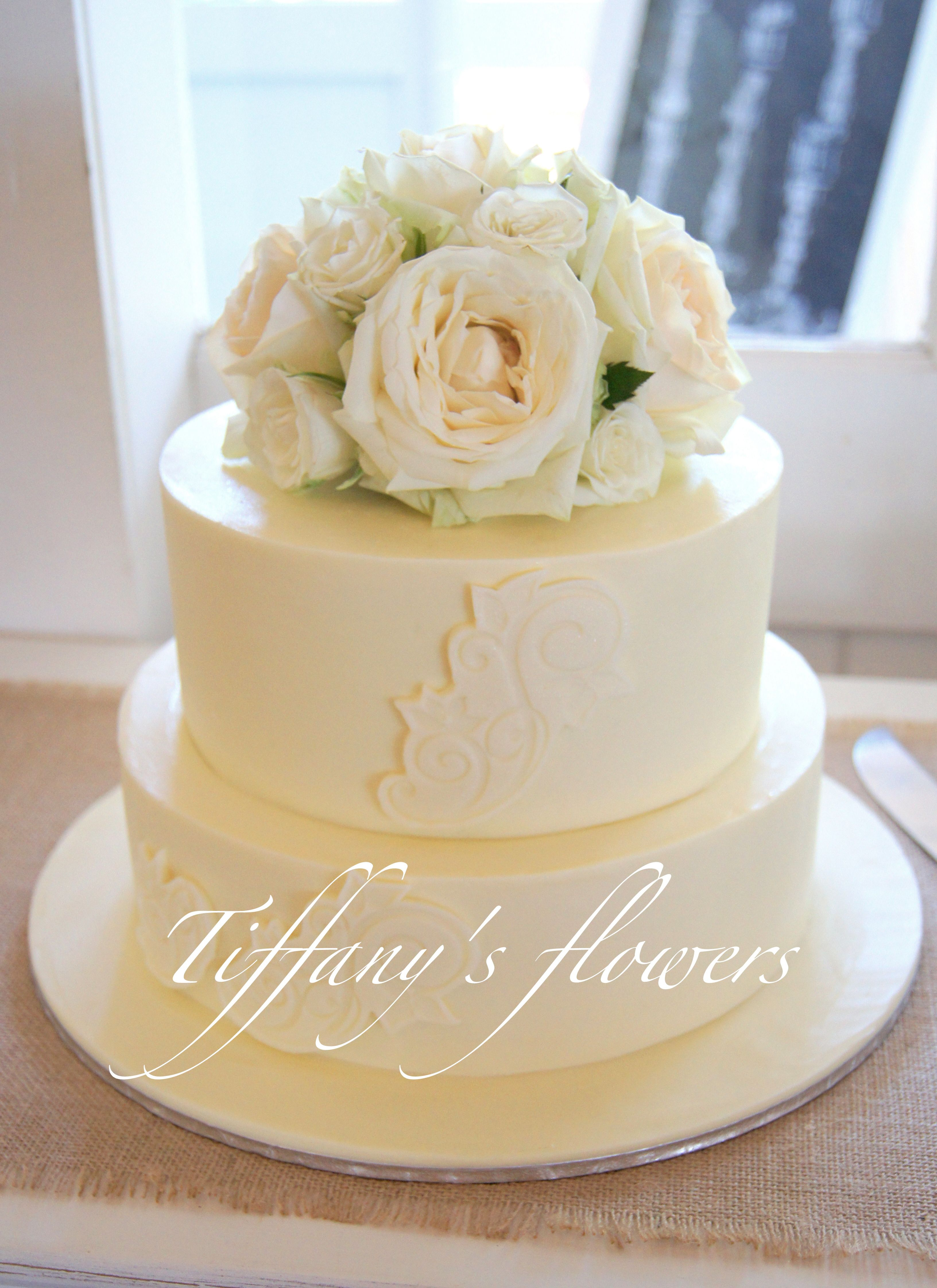 Stunning wedding cake designed by Cake Designs, with a pretty ivory ...