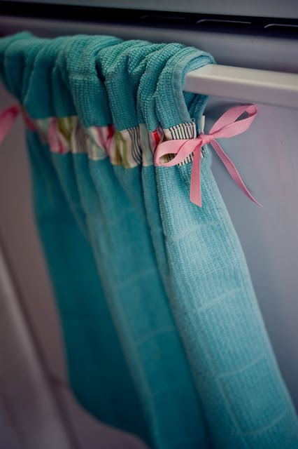 This website is in Spanish, but this is so easy.  Fold towel in half, measure down two inches from fold on both sides of the towel.  Mark this place.  Then sew fabric or ribbon across width of towel.  Feed a ribbon through for tying into bows.