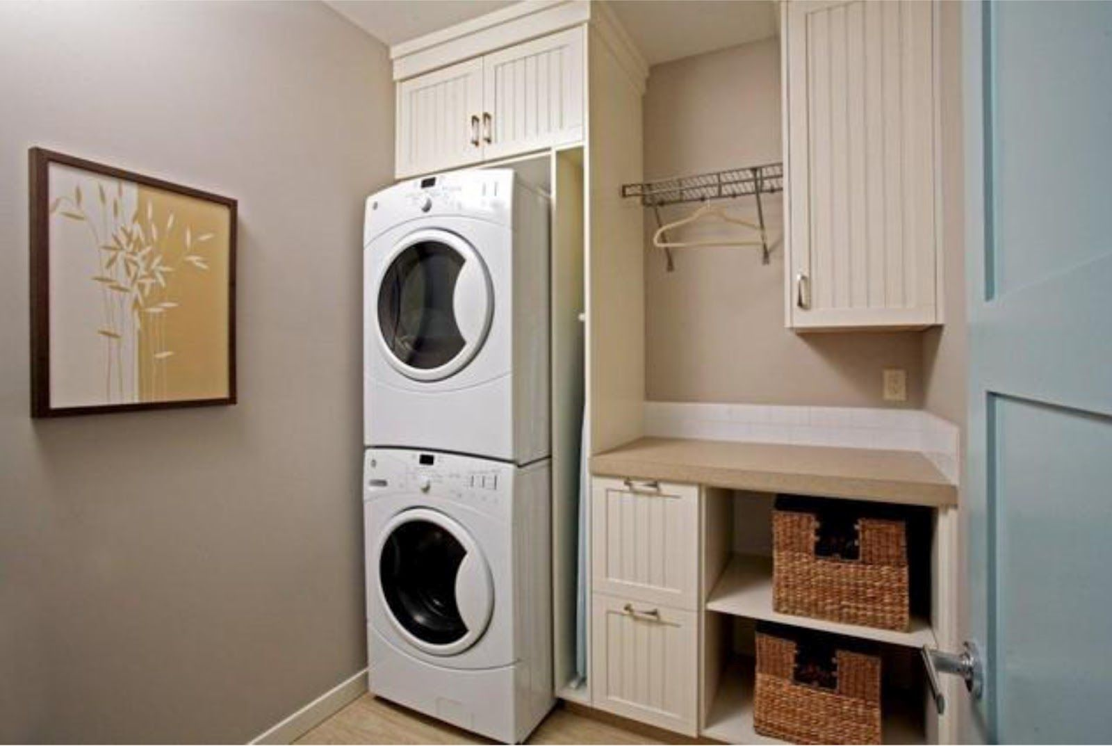 Work surface for washer and dryer - Stacked Washer And Dryer Laundry Layout Great For A Small Space I Like How There S A Cubby For The Ironing Board A Rod To Hang Clothes A Work Surface To