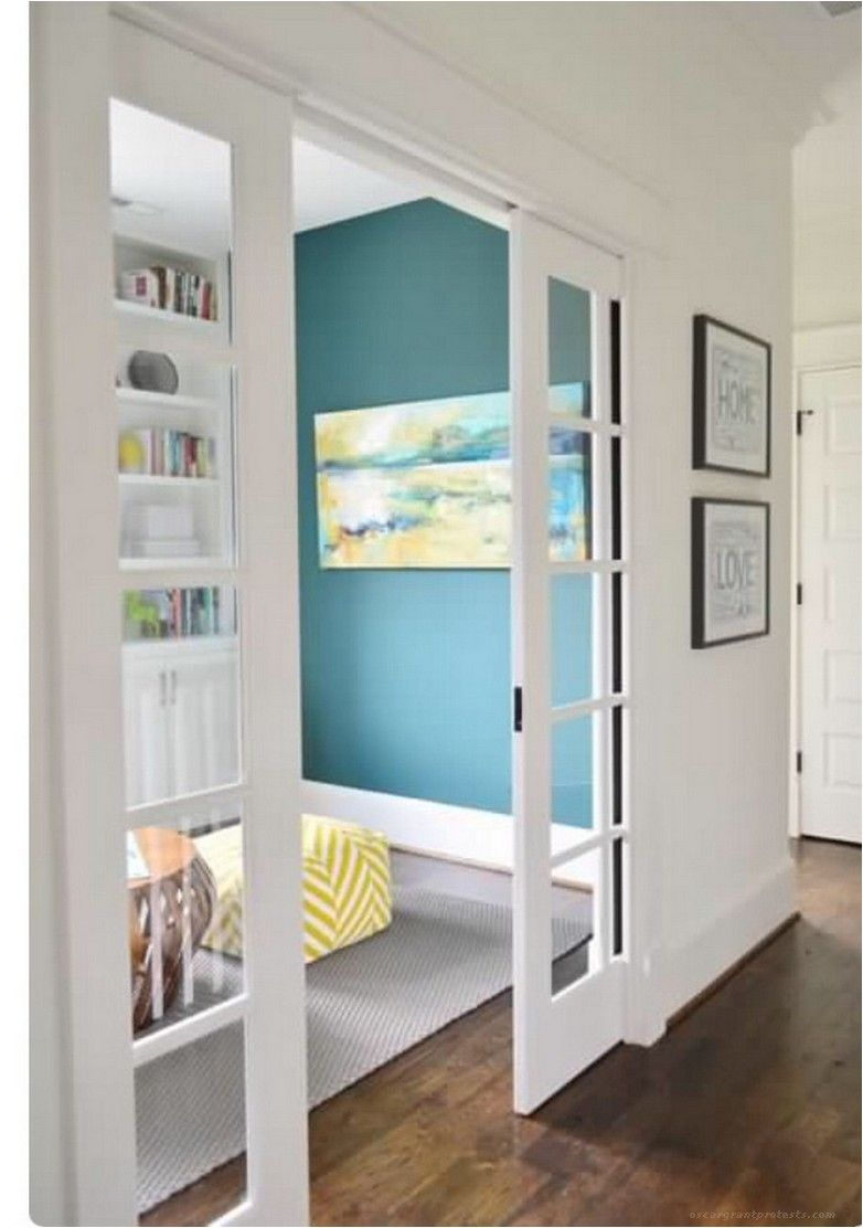 Sliding door to separate playroom from foyer (even a solid
