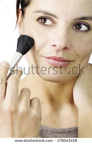 beautiful  brunette woman making up by Donatella Tandelli, via Shutterstock