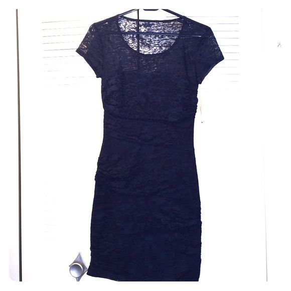 Macy's navy bodycon dress size 5/6 NWT! New with tags dress from Macy's. This dress does not have a brand. Bodycon with super flattering detailing. Fits size 5/6. Macy's Dresses Mini