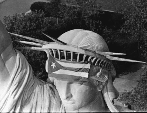 Puerto Rico People  Puerto Rican Flag On Statue Of Liberty