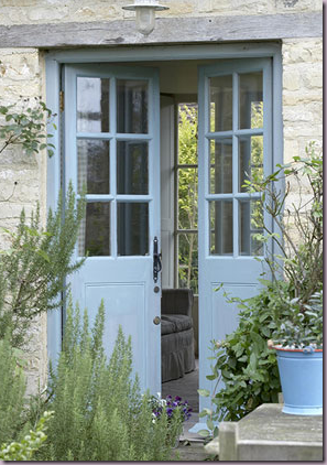 French blue french doors surrounded by beautiful for Small double front doors