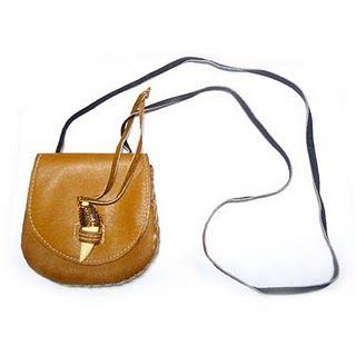 Handcrafted Leather Pouch with Bone and Wire Details S$38