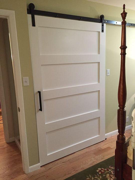 white 4 panel door with modern hardware in dark bronze barn doors rh pinterest com