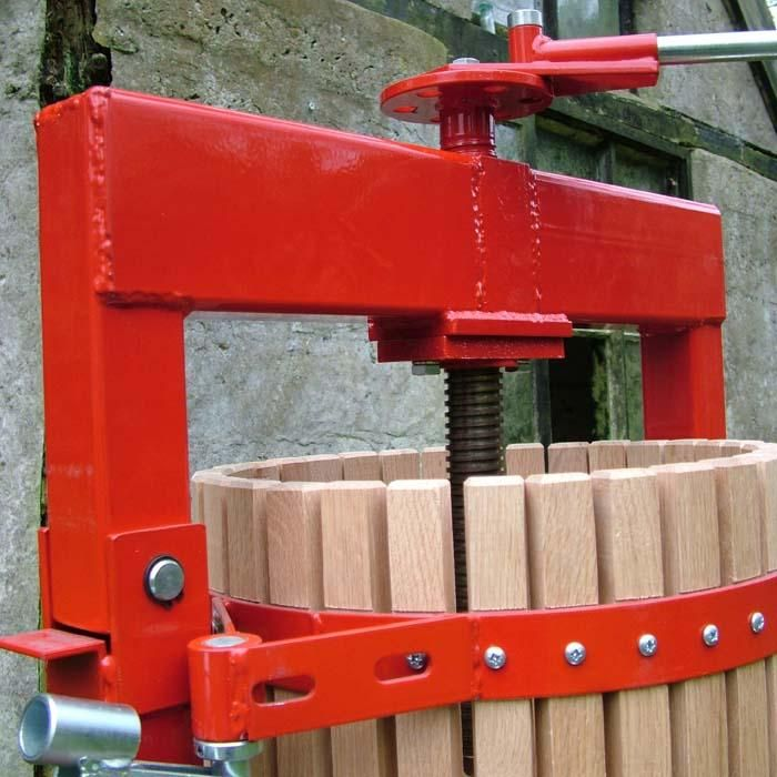 A cross-beam fruit press with large capacity juicing abilities.