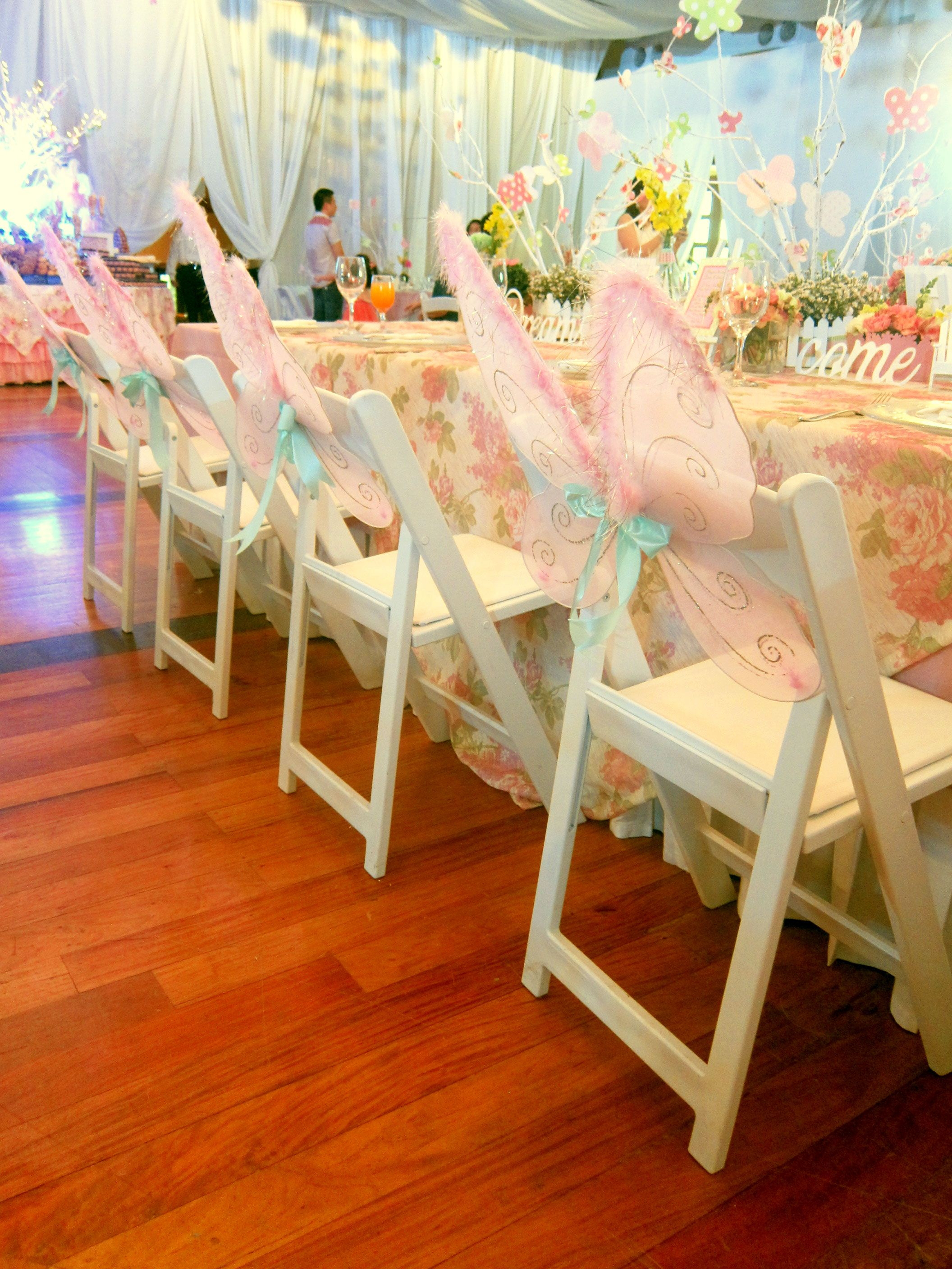 Reserv S White Folding Chairs At A Fairy Garden Themed Kid Party By Planners Plus The