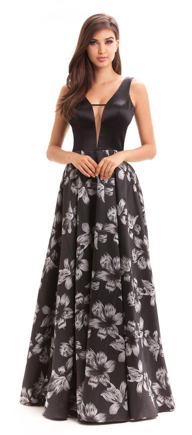 9914a026d Vestido longo de busto de crepe acetinado com decote profundo em tule  invisível para dar mais segurança à quem veste. Saia rodada com pregas em  tema floral.