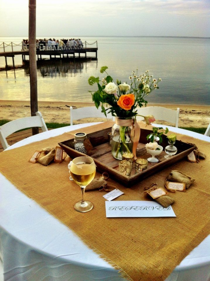 Sunset wedding on a pier! Tables in rustic vintage!